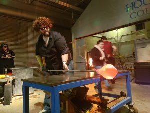 A man practices the art of glassblowing