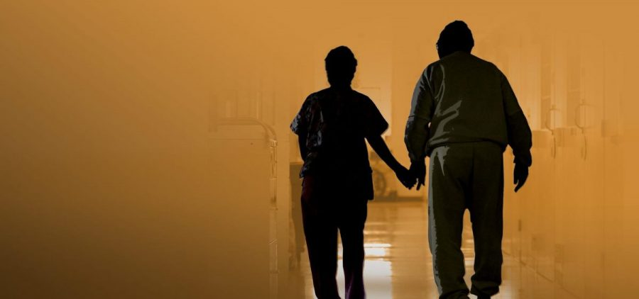 Two people walk while holding hands