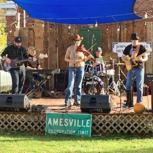 A band plays on stage in Amesville