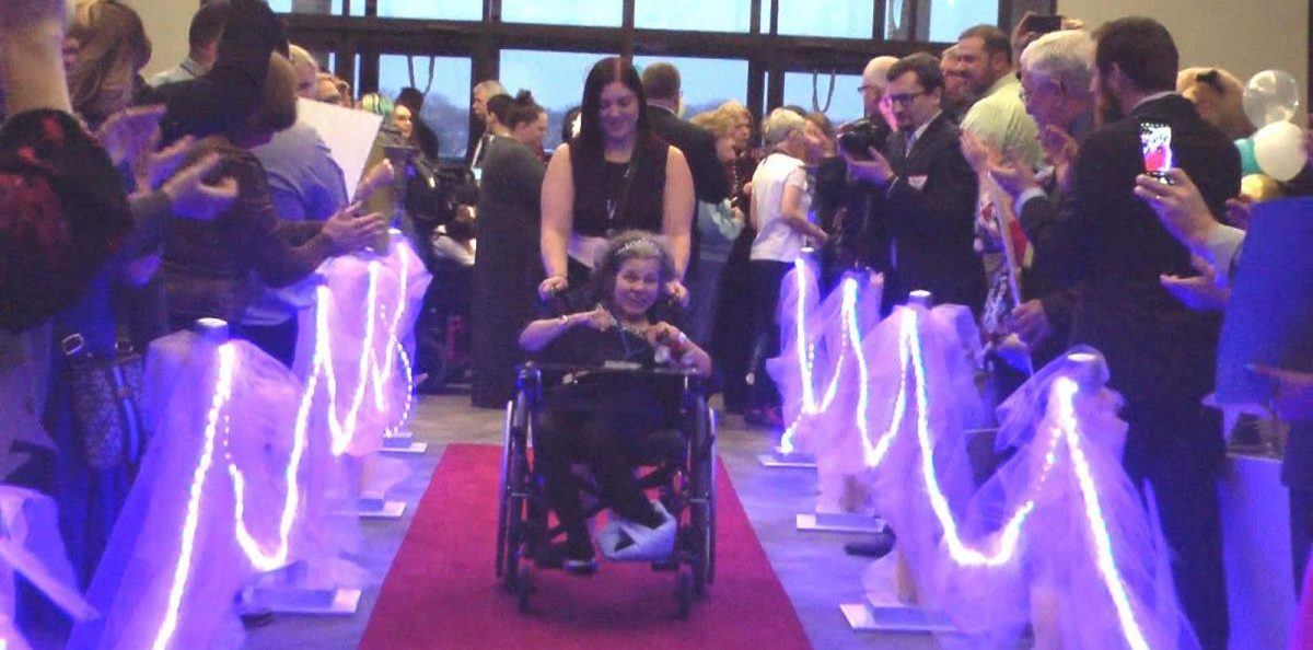 People walk down the red carpet during Night to Shine event