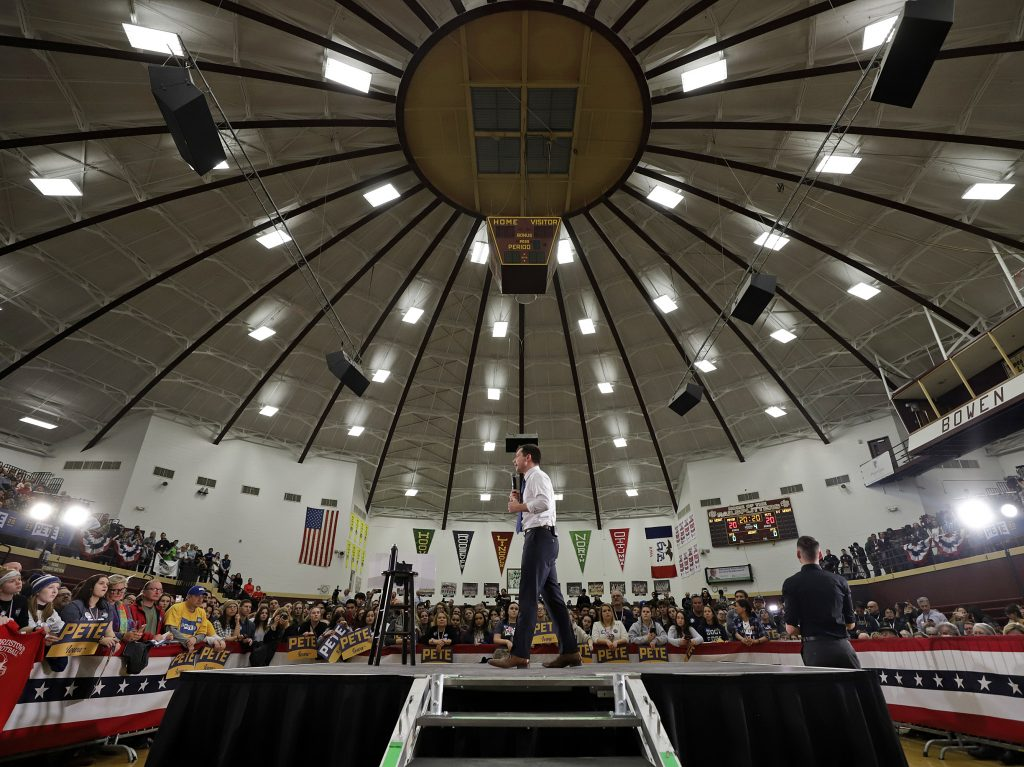 Former South Bend, Ind., Mayor Pete Buttigieg speaks at a Get Out the Caucus event at Lincoln High School in Des Moines, Iowa, Sunday, where 2,000 people attended.
