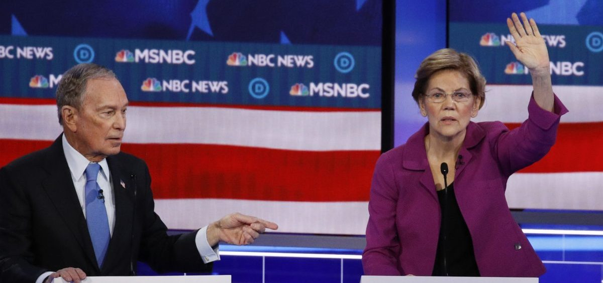 Democratic presidential candidate Sen. Elizabeth Warren, D-Mass., gestures during the debate, as fellow candidate, former New York Mayor Mike Bloomberg, looks on.