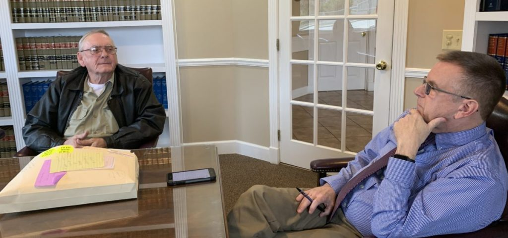 Lynn Stanley, left, is caught up in changes to the law that may make it more difficult for him to win black lung benefits. On right, his attorney Tom Moak.