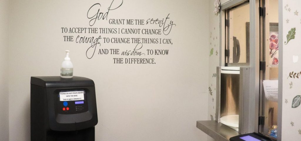 Patients at Maryhaven walk in this room and a provider gives them their MAT treatment. The serenity prayer, commonly used in twelve-step programs, is on the wall.