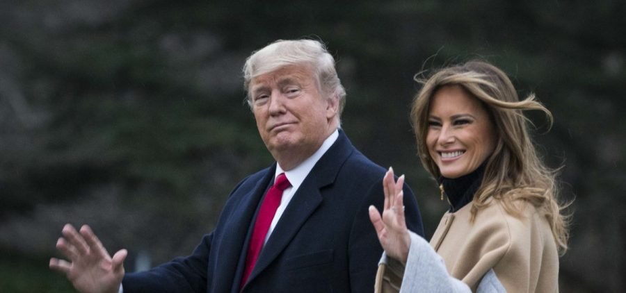 President Trump and first lady Melania Trump walk along the South Lawn as they depart from the White House for a weekend trip to Mar-a-Lago in Florida on Friday.