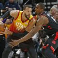Toronto Raptors center Serge Ibaka (9) guards against Utah Jazz center Rudy Gobert (27) in the first half during an NBA basketball game Monday, March 9, 2020, in Salt Lake City.