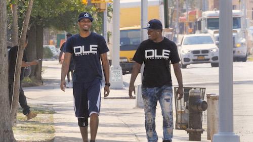 Danny and Raymond Jacob walking down city sidewalk