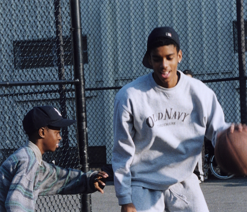 Danny and Raymond Jacob on the basketball court in 1997