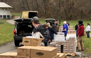 Loading cars at Meigs County food distribution