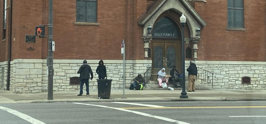 People gather outside Holy Family Church in Columbus, which does outreach to the homeless in Franklin County.