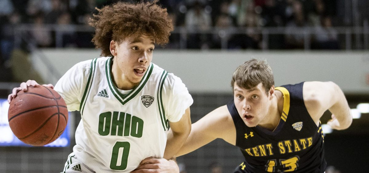 Ohio's Jason Preston dribbles the ball against Kent State's Mitch Peterson