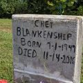 Chet Blankenship was buried in the lawn beside his home.