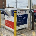 A box to drop off absentee ballots sits in the parking lot of the Cuyahoga County Board of Elections in Cleveland.