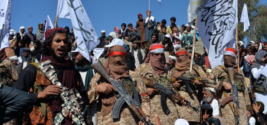 Militants linked with the Afghan Taliban gather Monday for a ceremony in Laghman province, celebrating the agreement the group signed with the U.S. over the weekend. Since the deal was announced, the Taliban has resumed its attacks in Afghanistan.