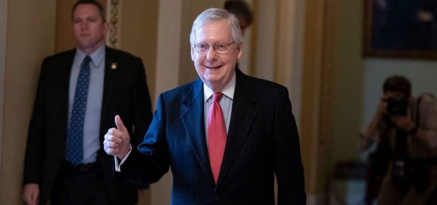 Senate Majority Leader Mitch McConnell leaves the Senate floor on Wednesday as the U.S. Senate was poised to pass a massive relief package for Americans and businesses ravaged by the coronavirus pandemic.