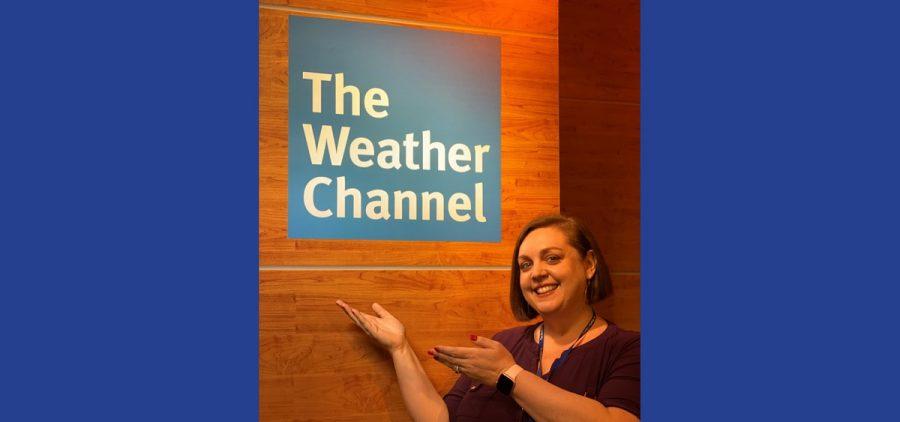 Angie Massie in front of Weather Channel sign