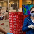Even without symptoms, you might have the virus and be able to spread it when out in public, say researchers who now are reconsidering the use of surgical masks.