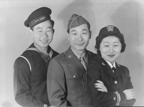 ASIAN AMERICAN family in uniform facing camera