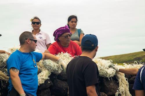 Natives on easter Island preparing to clean coastline