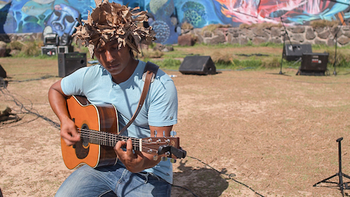 Native of Easter Island doing guitar soundcheck