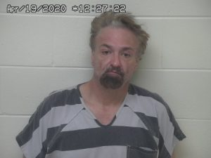 Mugshot of a man in a black and white striped shirt.