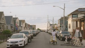 A cyclist carts a freezer through the Rockaways.