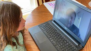 Clara works on her online schoolwork