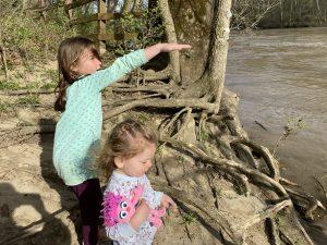 Clara and Sydney near a river