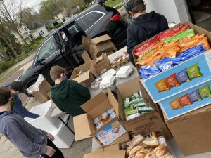 Volunteers help distribute boxed lunches