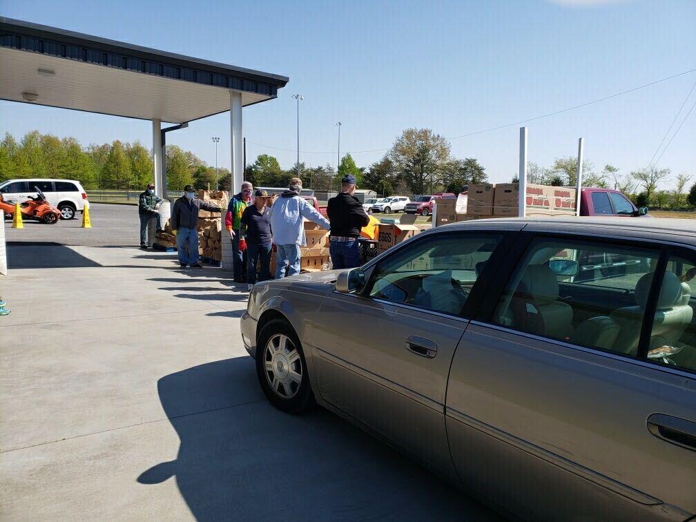 Volunteers with Murray-Calloway County Needline food pantry distribute drive-thru food packages in west Kentucky.