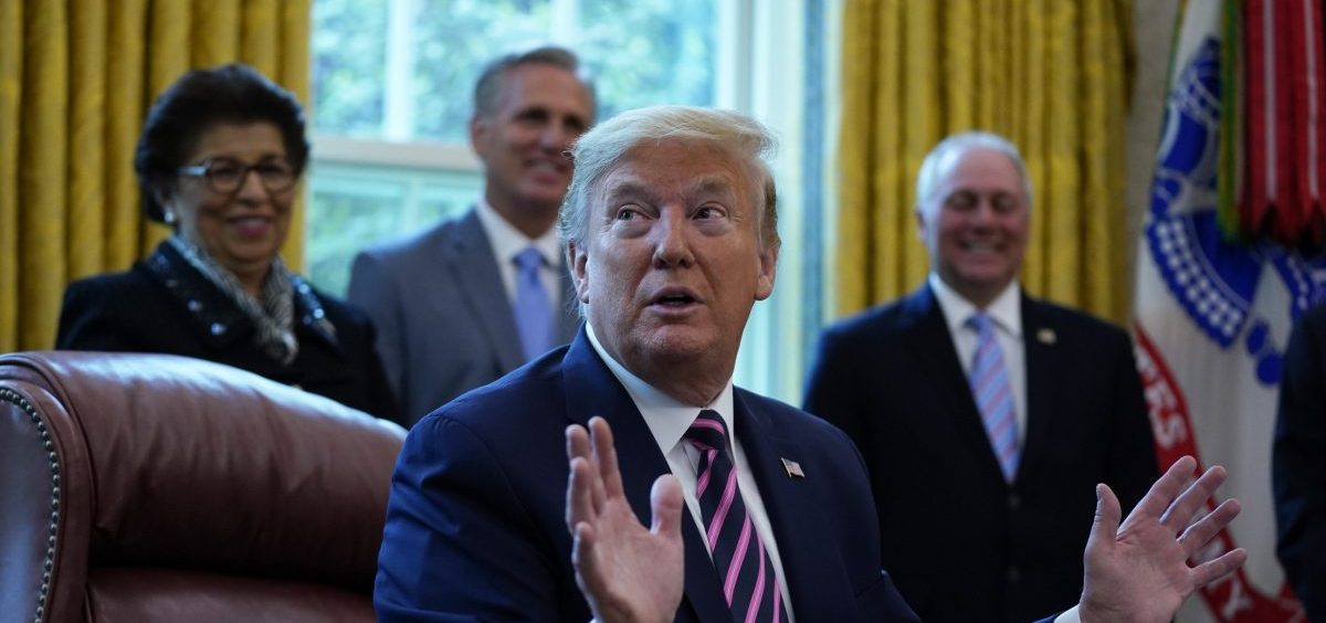 President Trump holds a signing ceremony on the latest coronavirus aid package in the Oval Office on Friday.