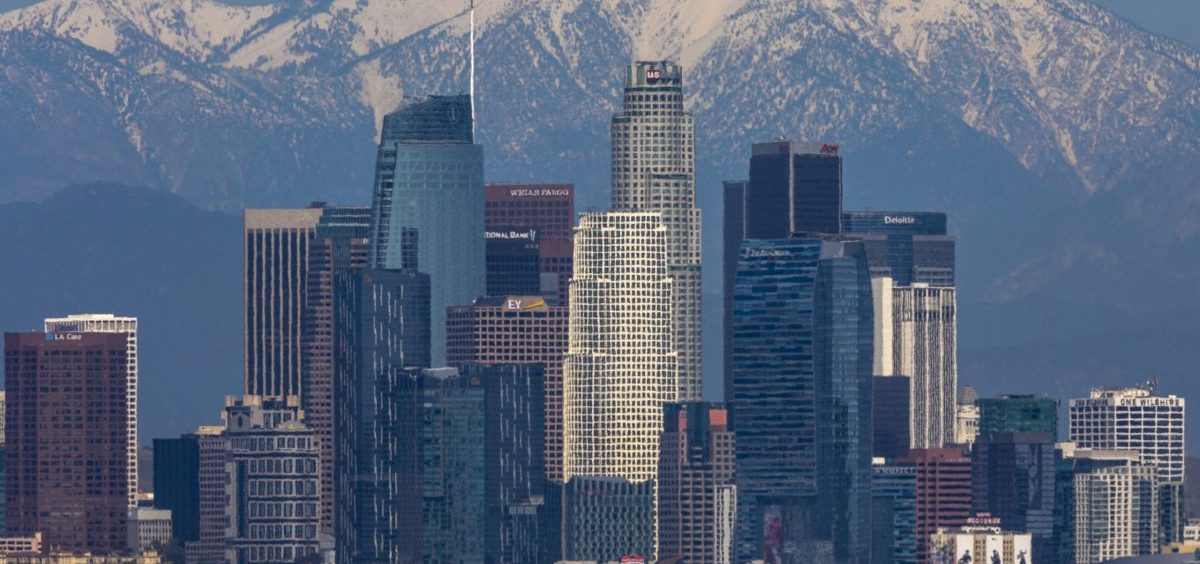 The San Gabriel Mountains are seen under a clear sky beyond downtown Los Angeles, after air quality was improved by  reduced traffic from coronavirus restrictions and weeks of storms.