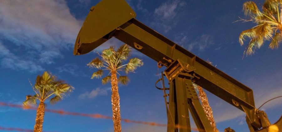Pump jacks draw crude oil near Long Beach, Calif., on March 9. A U.S. crude oil benchmark has hit 34-year lows.