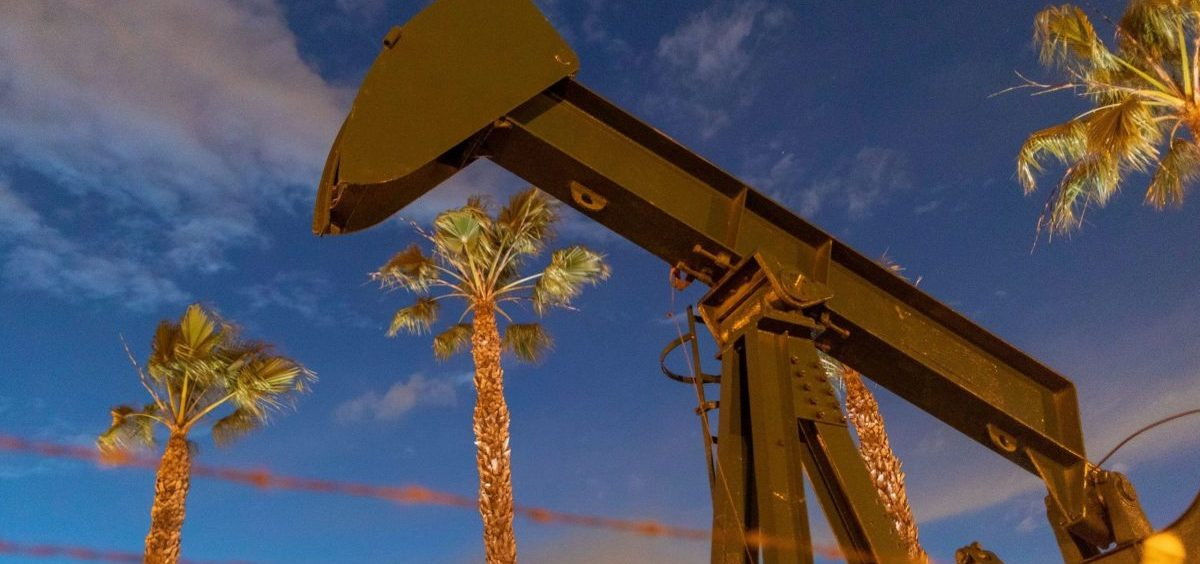 Pump jacks draw crude oil near Long Beach, Calif., on March 9. A U.S. crude oil benchmark has hit 34-year lows.