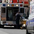 Ambulances are parked outside of Wyckoff Hospital in the Brooklyn, N.Y., on April 4. A study published by the CDC finds that people in the United States under the age of 18 are far less likely to fall ill with COVID-19 or require intensive care, compared with older Americans.