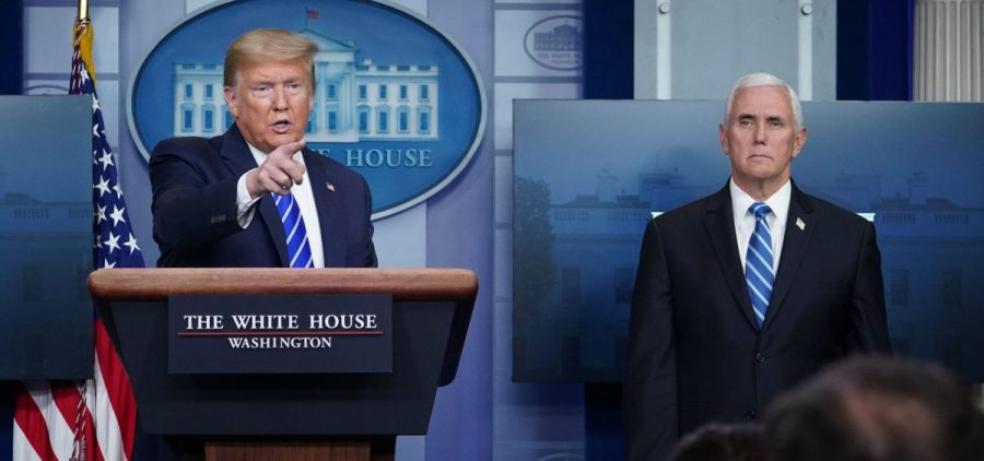 President Trump, flanked by Vice President Mike Pence, speaks during the daily briefing on the novel coronavirus at the White House Thursday.