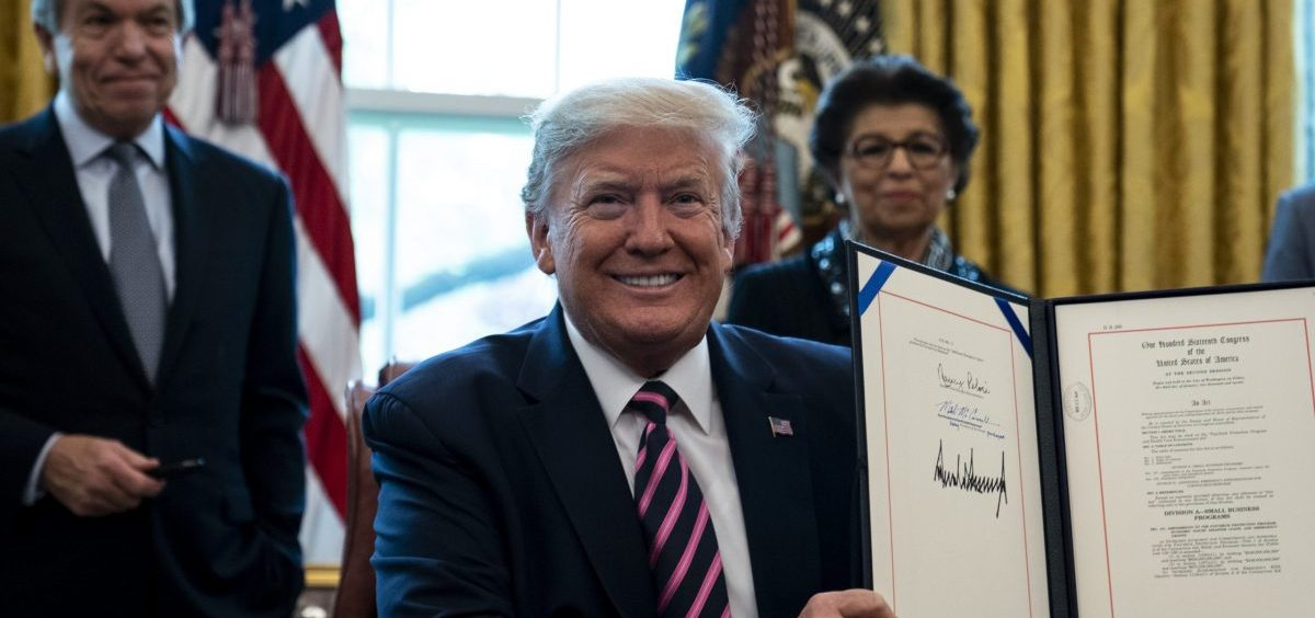 President Trump signs the Paycheck Protection Program and Health Care Enhancement Act last week. The law added billions for loans for small businesses through the PPP.