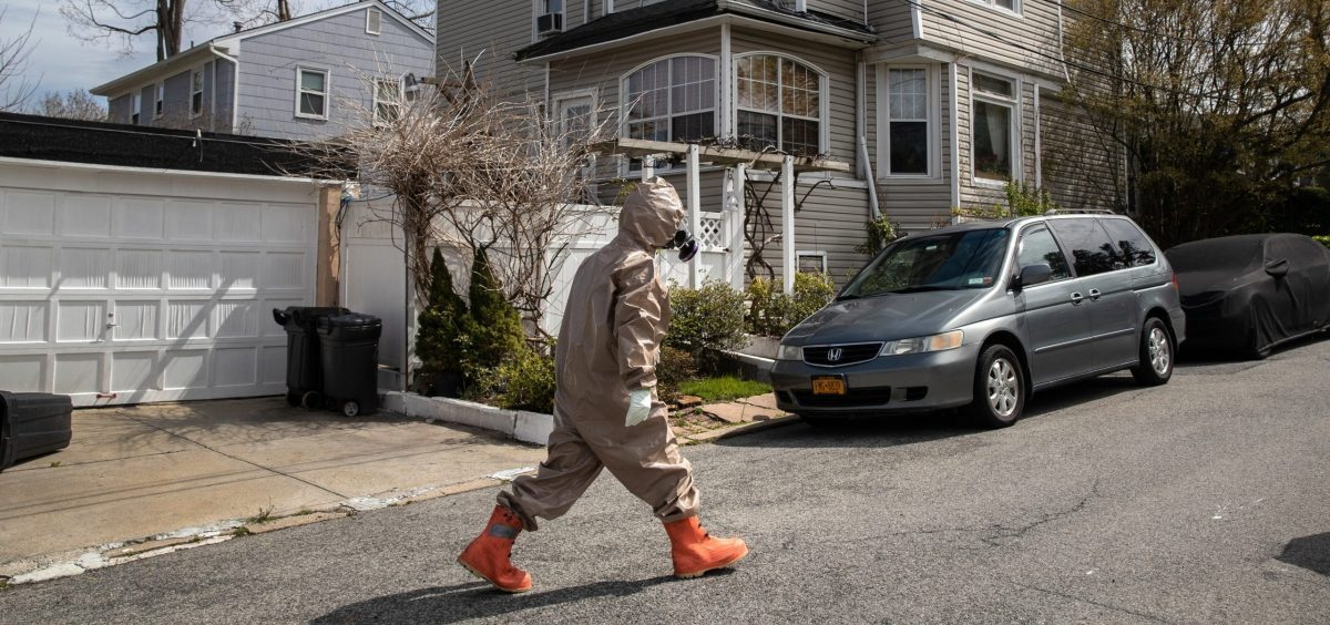 A Yonkers Fire Department EMT wears full personal protective equipment during the coronavirus shutdown in Westchester County, New York. County leaders across the country say they need help paying for essential services as the shutdown continues.