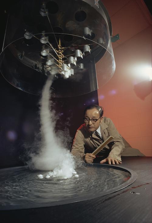 Tetsuya Fujita studies a tornado formation in his lab