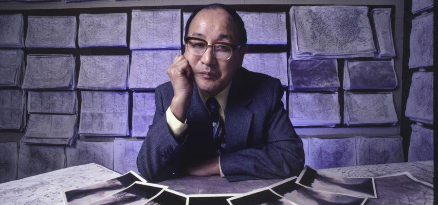 professor Fujita in lab with documents