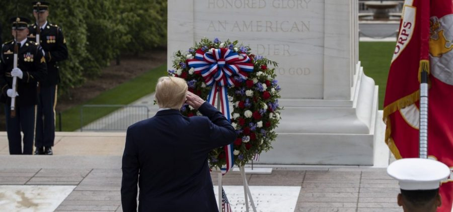President Donald Trump salutes after placing a wreath at the Tomb of the Unknown Soldier in Arlington National Cemetery, in honor of Memorial Day, Monday, May 25, 2020, in Arlington, Va.
