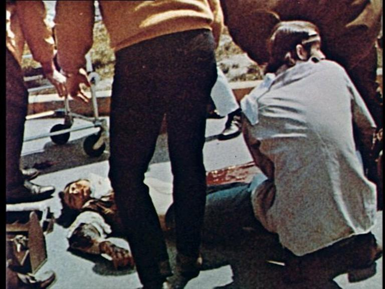 People stand around 1970 Kent State University shooting victim, Ohio