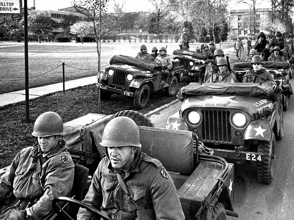National Guardsmen patrol empty Kent State University campus after three-day riot with students, Kent, Ohio, B&W photo