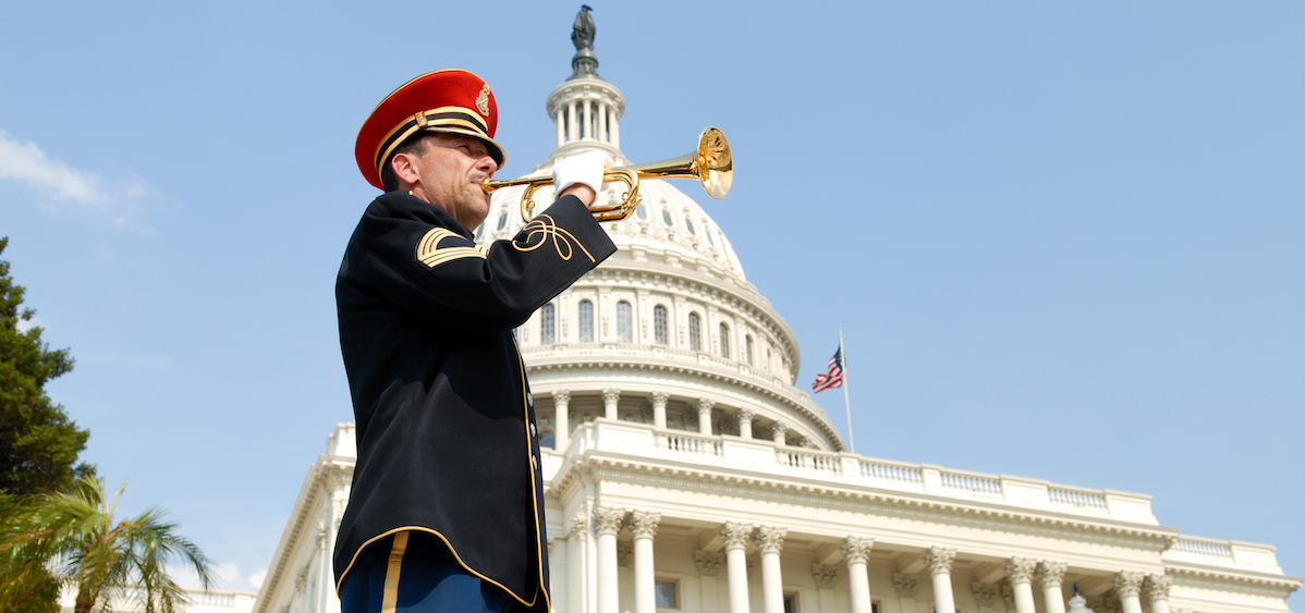 "A bugler plays ""Taps"" in honor of our fallen heroes during the NATIONAL MEMORIAL DAY CONCERT, broadcast live from the U.S. Capitol."