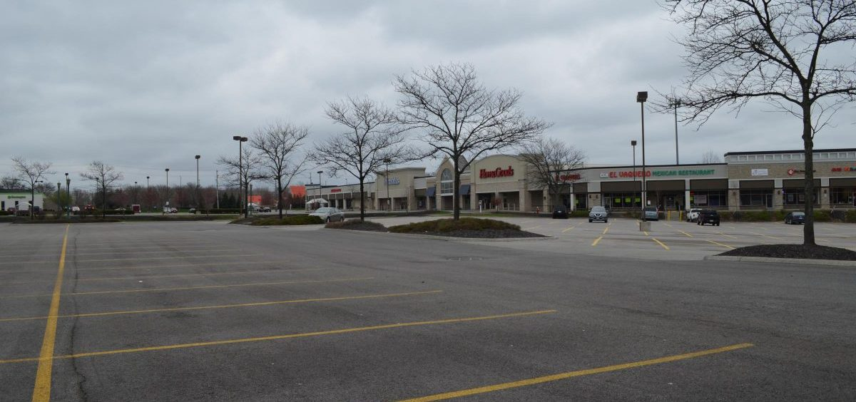 A nearly empty parking lot at a shopping area on the northeast side of Columbus in April 2020.