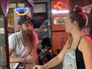 On Thursday, May 14, 2020, Locke Wolf, left, and his sister Adrienne Whitney discuss getting the Smiling Skull Saloon open for outdoor seating the next day.