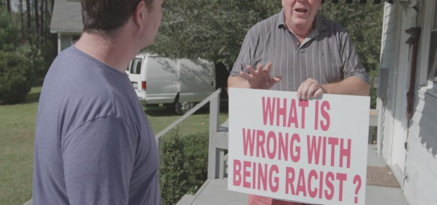 """Russell Walker, Republican for North Carolina, State House District 48 holding """"whats wrong with being racist"""" sign"""