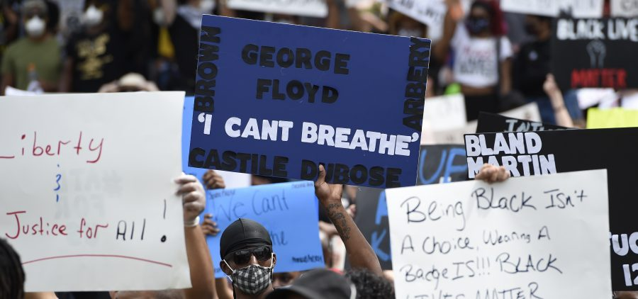 Demonstrators protest Friday in Centennial Olympic Park in Atlanta. Protests were organized in cities around the United States following the death of George Floyd during an arrest in Minneapolis. Former police officer Derek Chauvin was charged Friday with third-degree murder and manslaughter in the incident.