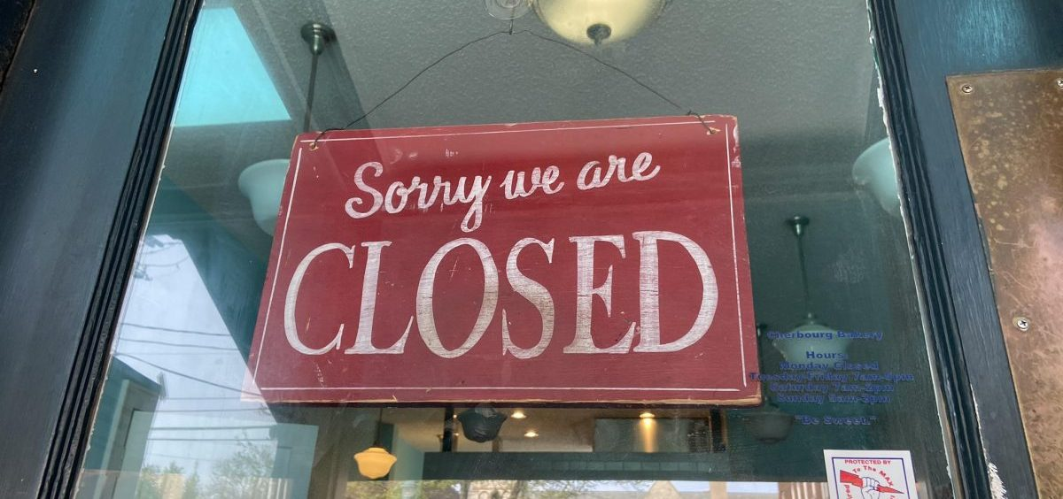 A closed sign in a store near downtown Columbus