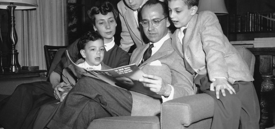 Dr. Jonas E. Salk, who discovered the polio vaccine, reads with his wife and three boys in Ann Arbor, Mich., on April 11, 1955. The boys were among the first vaccinated during testing. The family was photographed the night before an announcement the vaccine was effective. Pictured from left are Jonathan, 5; Donna Salk; Peter, 11; Salk; and Darrell, 8.